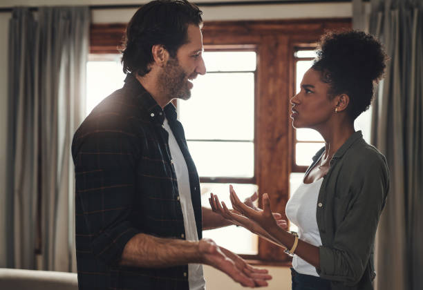 They've both reached breaking point Shot of a young couple having an intense argument at home relationship difficulties stock pictures, royalty-free photos & images