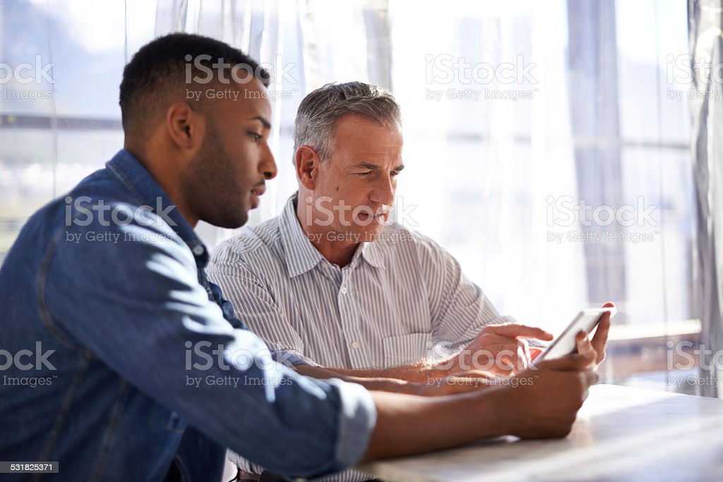 They've got a lot to learn from each other stock photo