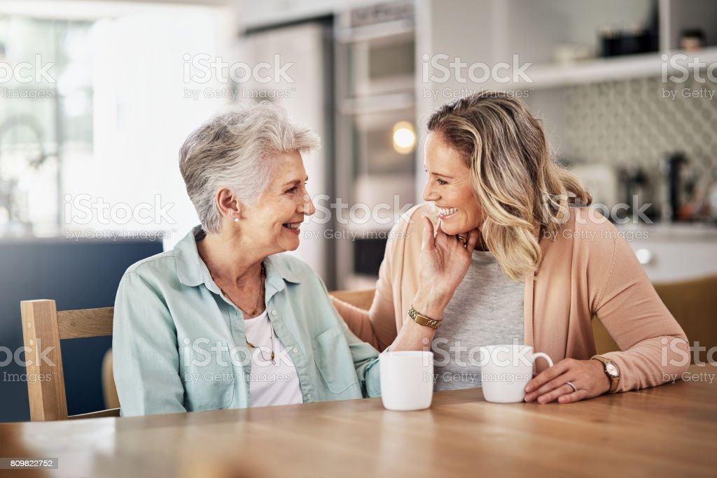 They've got that special mother-daughter bond stock photo