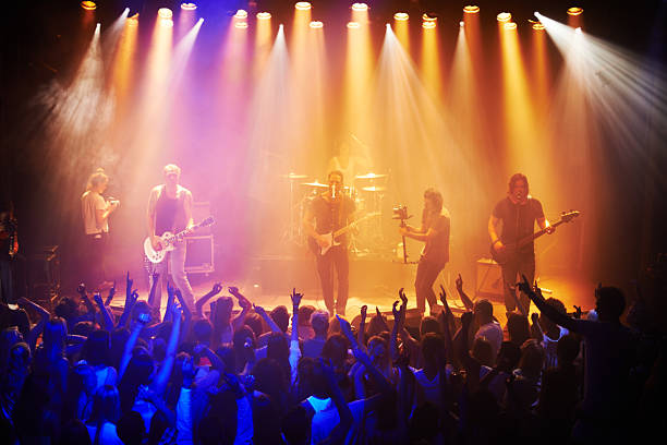 they've got the crowd in a musical trance - popular music concert stock photos and pictures