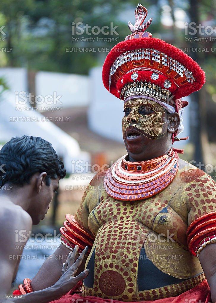 Theyyam, applying body make-up, Kannur, Kerala, India royalty-free stock photo