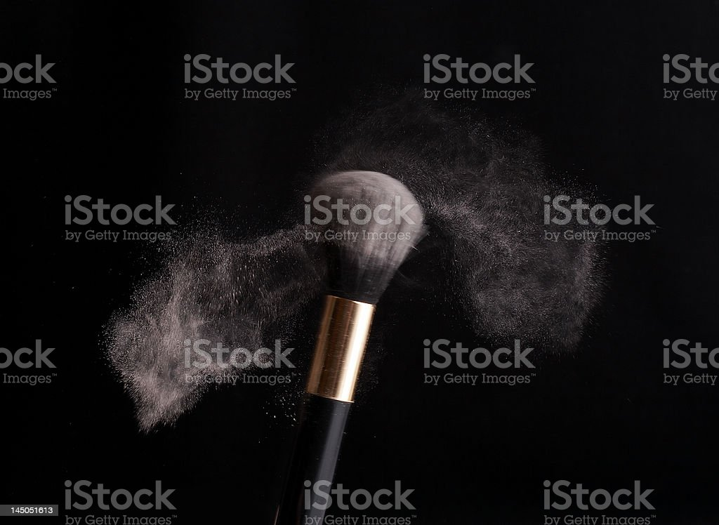 thick black brush in motion and powder dust royalty-free stock photo
