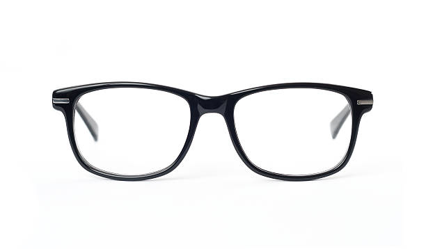 Thick black glasses on white background Thick black glasses on white background. Frontal shot. 2014 stock pictures, royalty-free photos & images