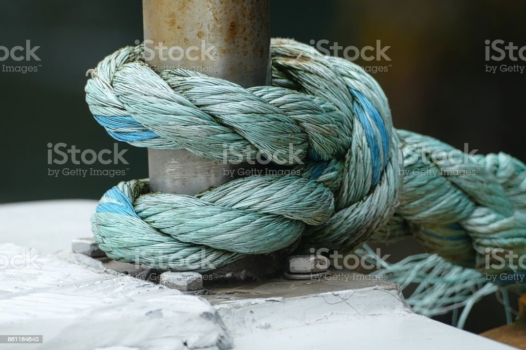 Thick blue ropes at the harbour stock photo