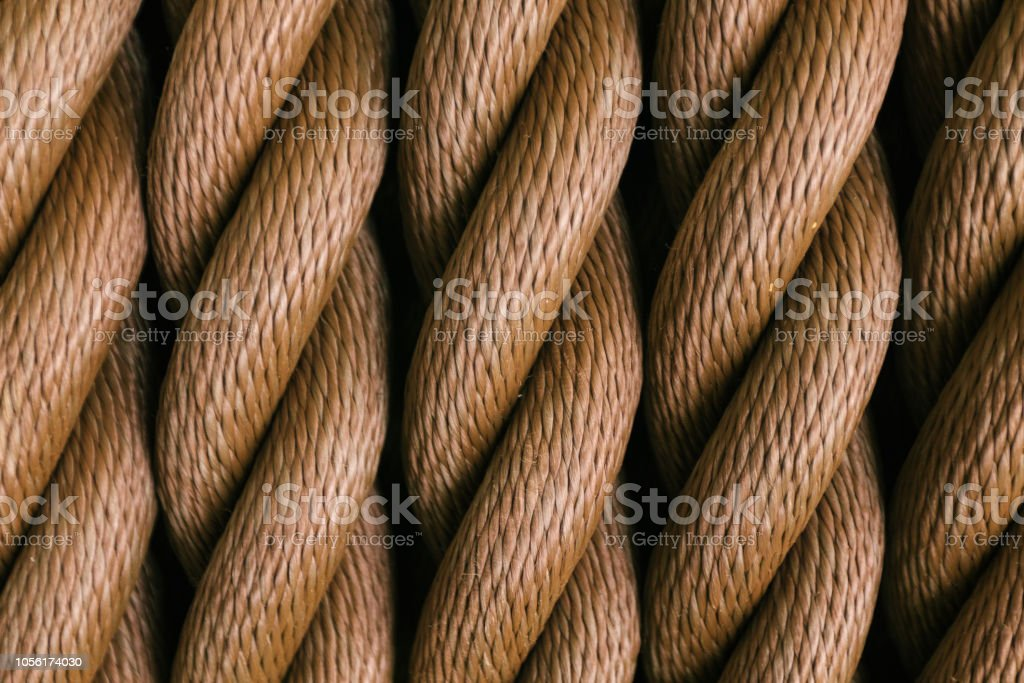 Thick brown rope rolled into a roll. Vertical layout stock photo