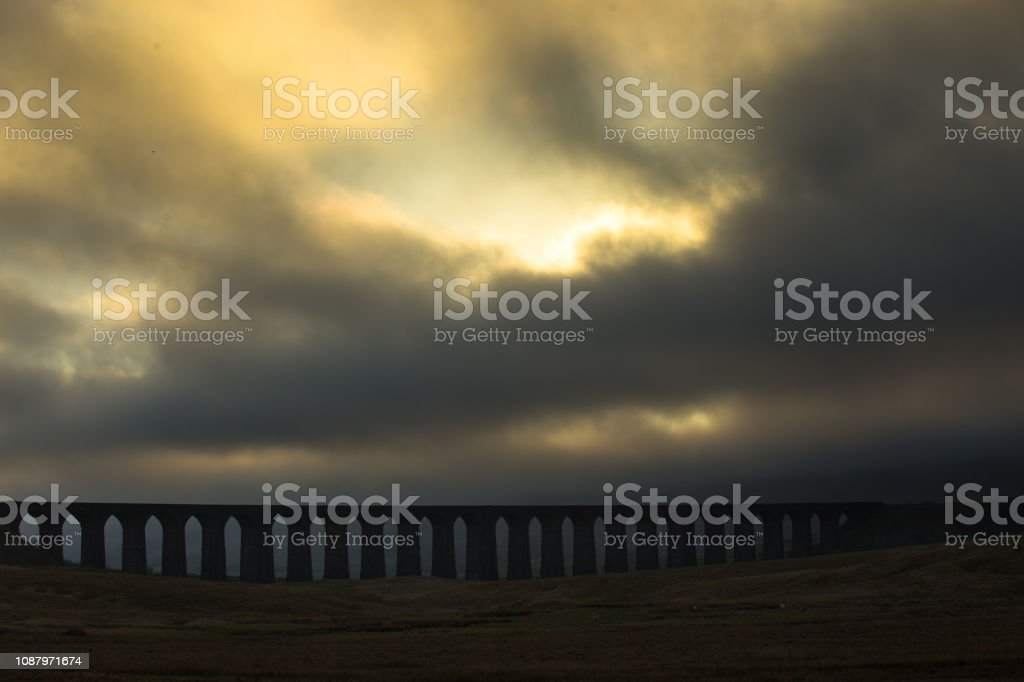 Thick Fog Around Ribblehead Viaduct at Sunset stock photo