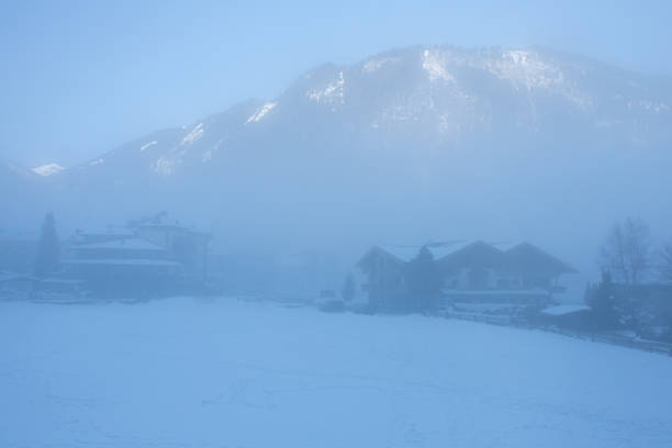 Thick fog with sun on top of ski moutain stock photo