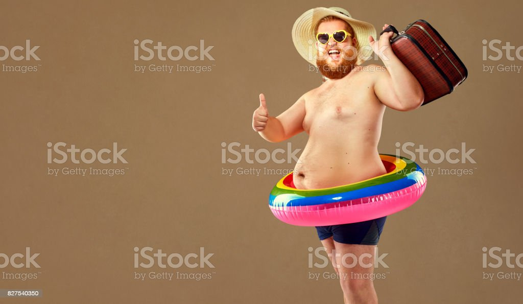 Thick funny man in swimming trunks wearing a hat and crocheted o stock photo