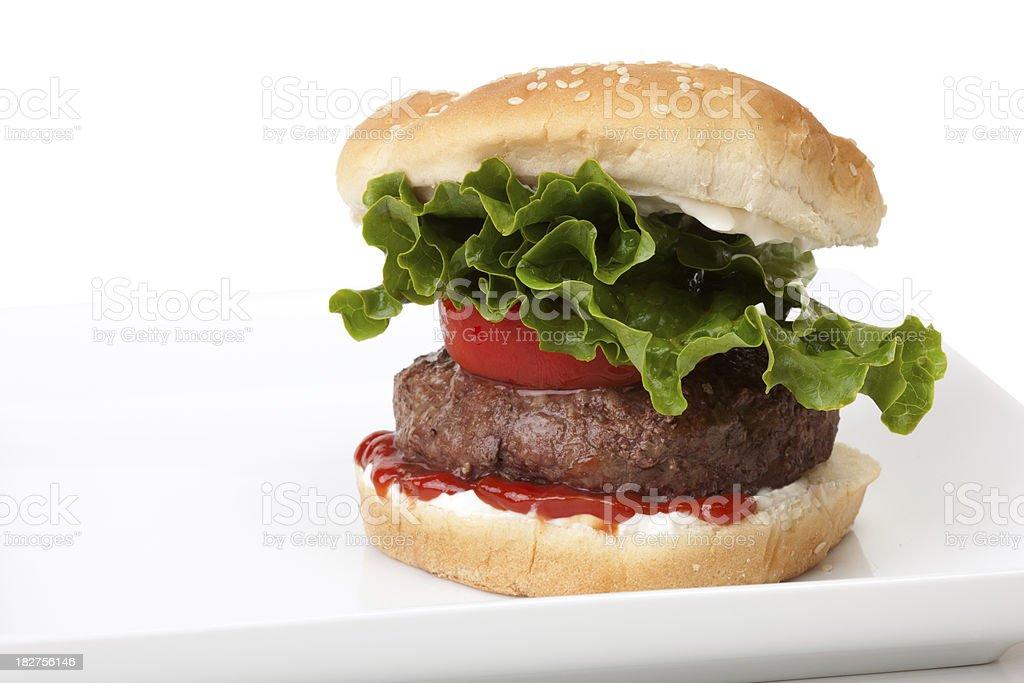 Thick juicy hamburger on white plate royalty-free stock photo