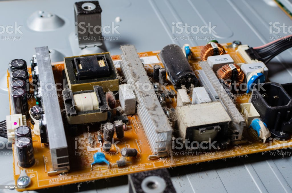 A Thick Layer Of Dust Covers The Internal Electronic Components Of