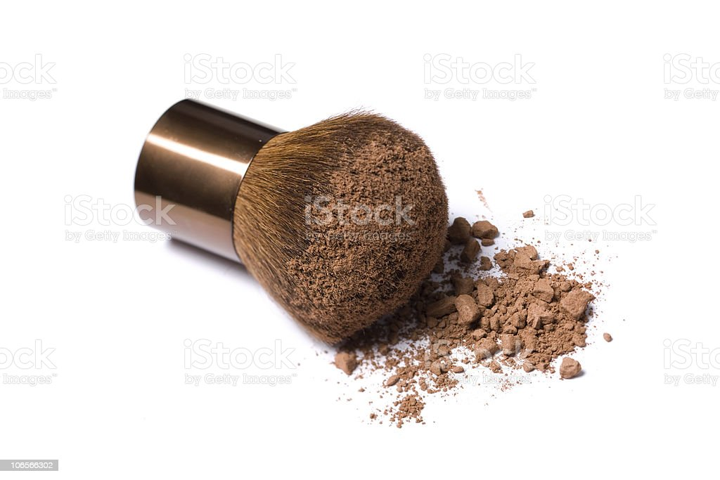 Thick makeup brush with brown powder on white background royalty-free stock photo