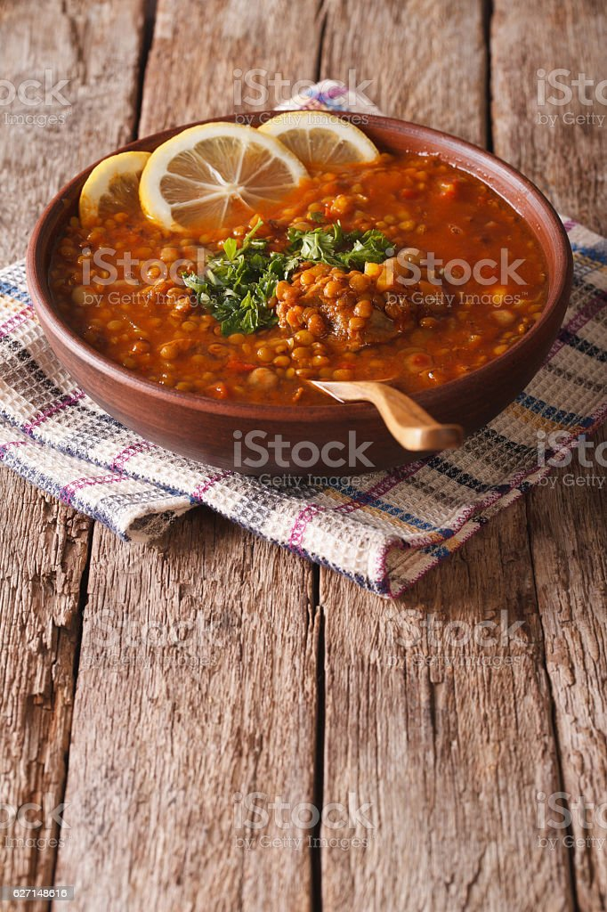 Thick Moroccan soup in a bowl on the table. vertical stock photo