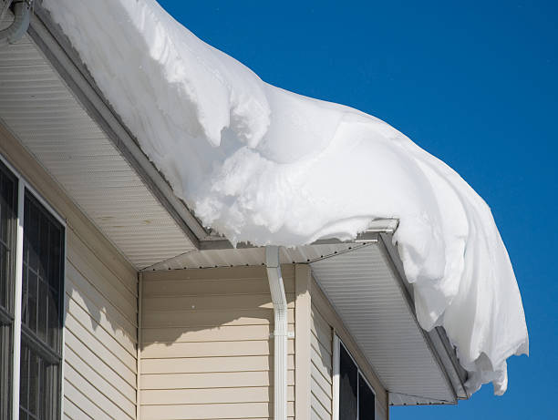Thick pile of snow on the rooftop of a house stock photo