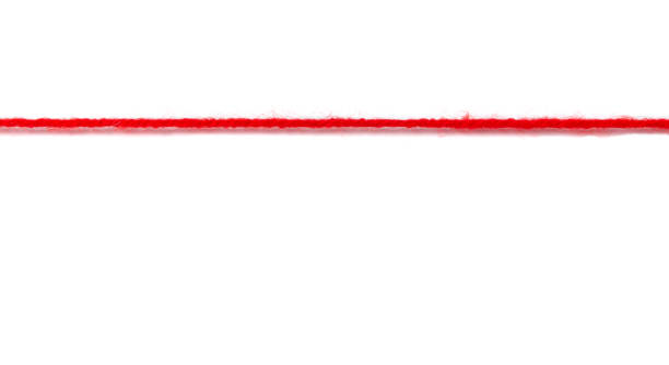 Thick red woolen thread on a white background. nerves to the limit concept stock photo