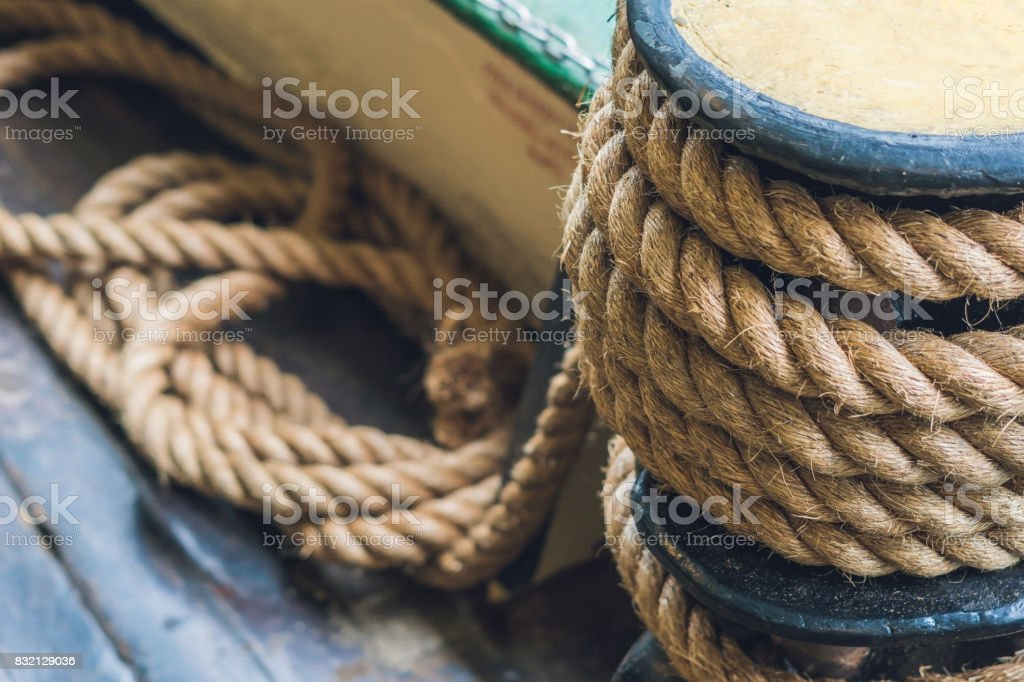 A thick rope on a ship, a ferry for tethering stock photo
