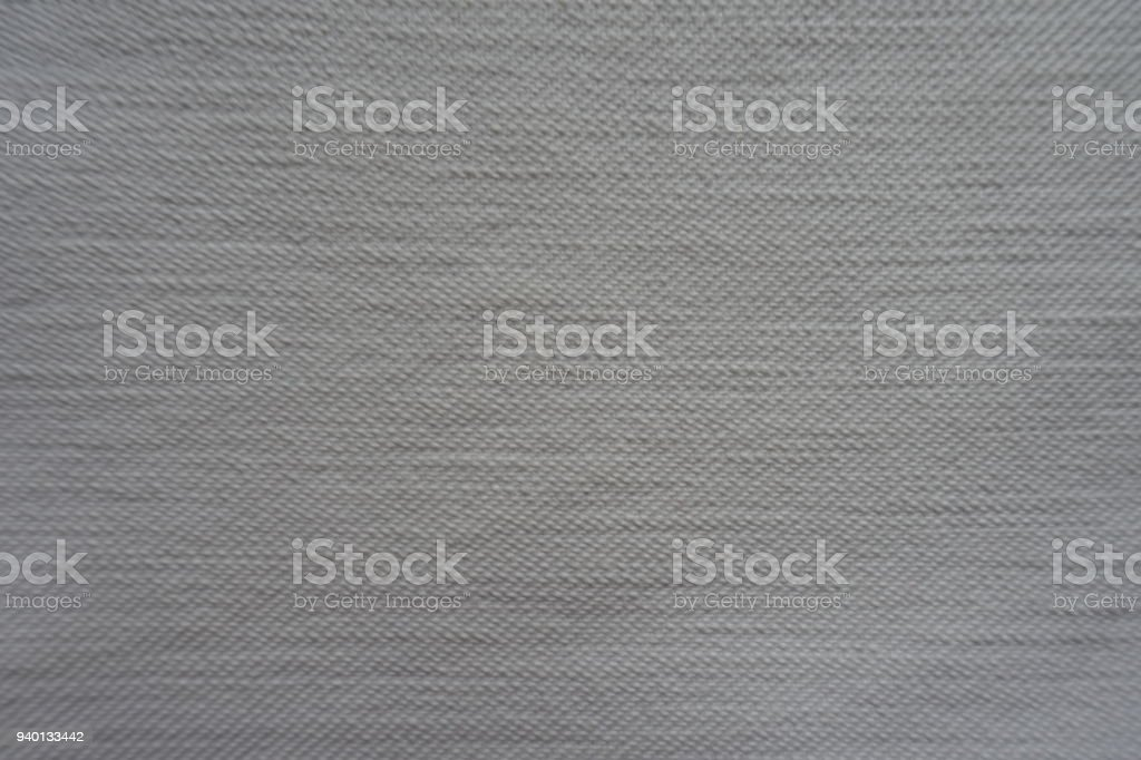 Thick rough  white denim fabric from above stock photo