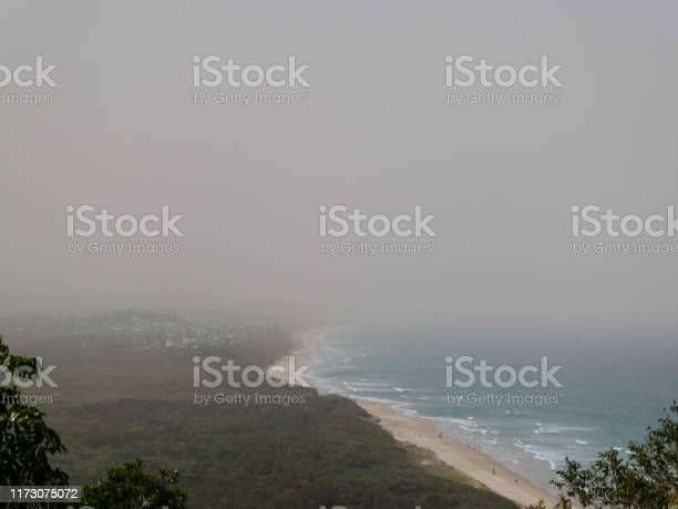 A thick smoke and dust haze over the Sunshine Coast, Australia, due to bushfires in Queensland and northern NSW