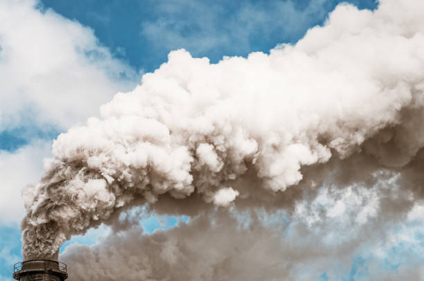 Thick smoke coming from an industrial chimney stock photo