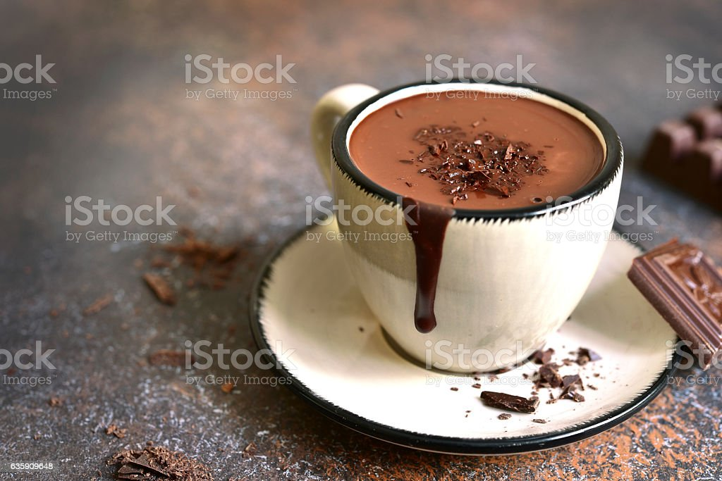 Thick spicy hot chocolate in a cup. - foto de acervo