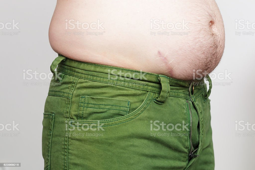 Thick white male barely buttoned jeans stock photo