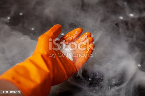 Thick white smoke on a background of black ceramic tiles. Dry ice tobacco