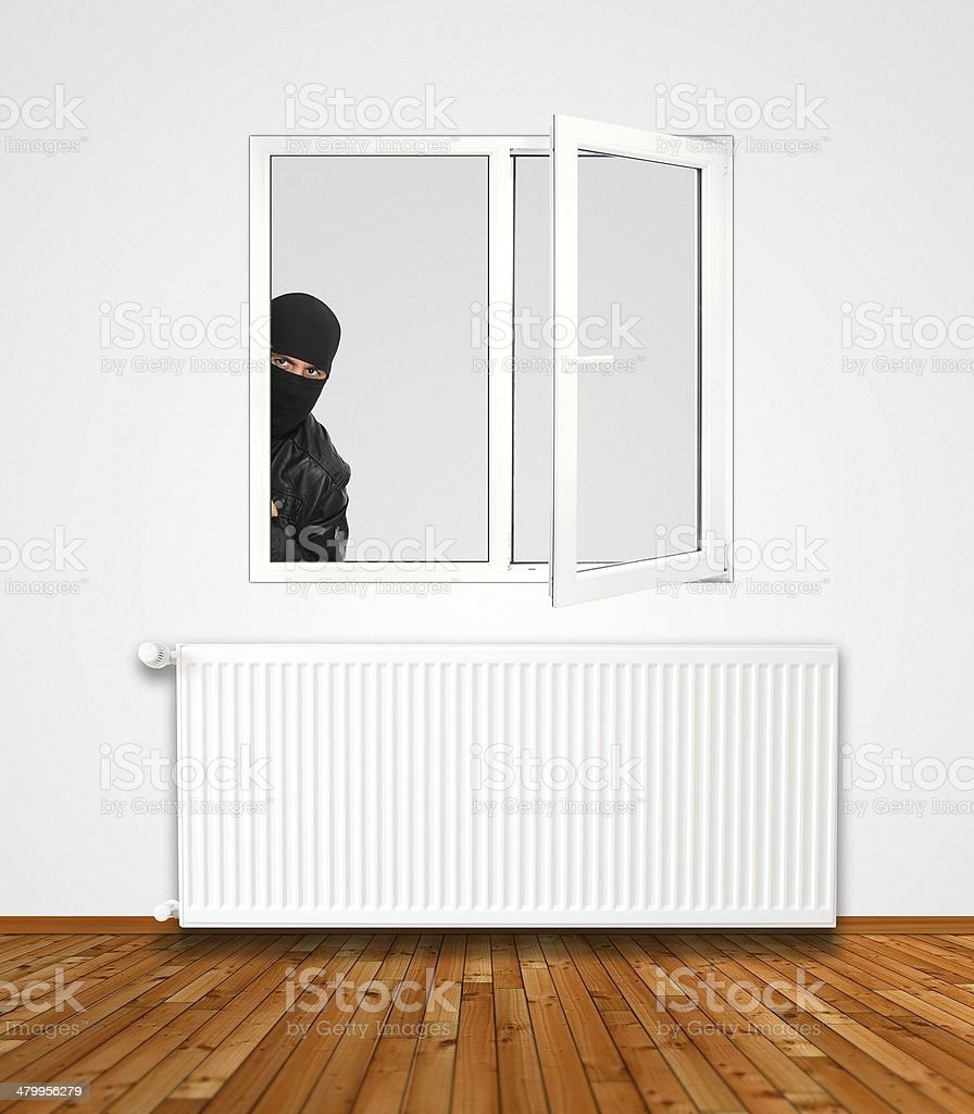 Thief at the window stock photo