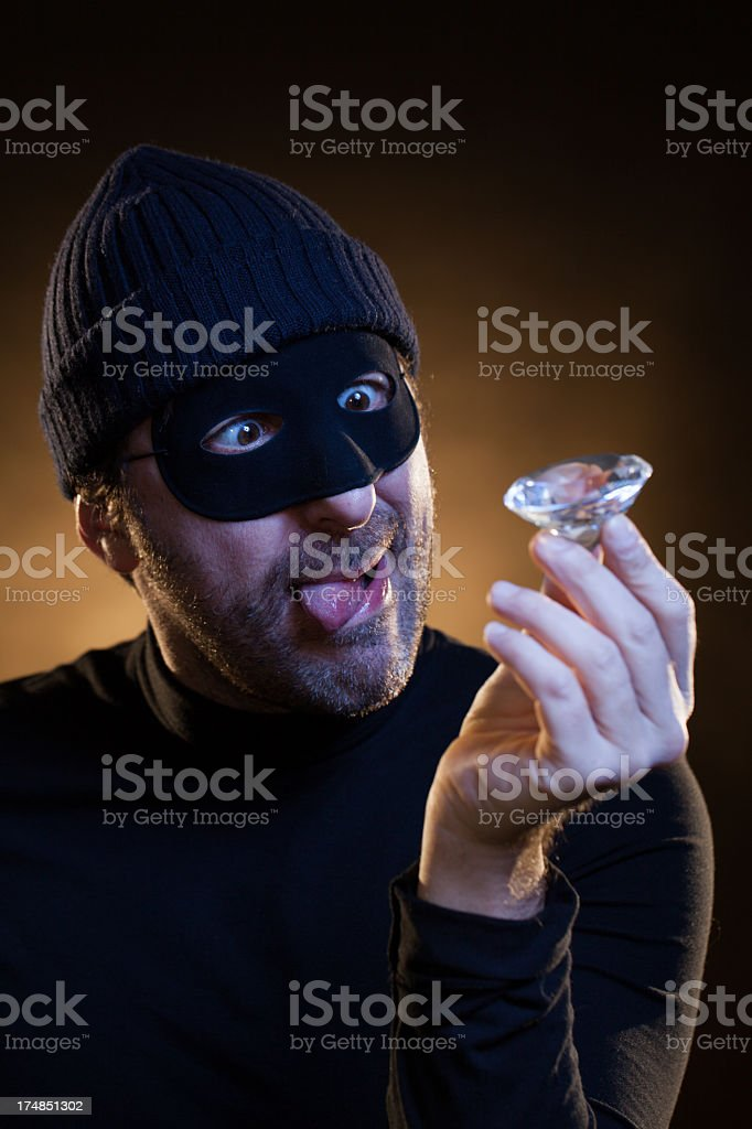 Thief Crazy for His Just Stolen Big Diamond stock photo
