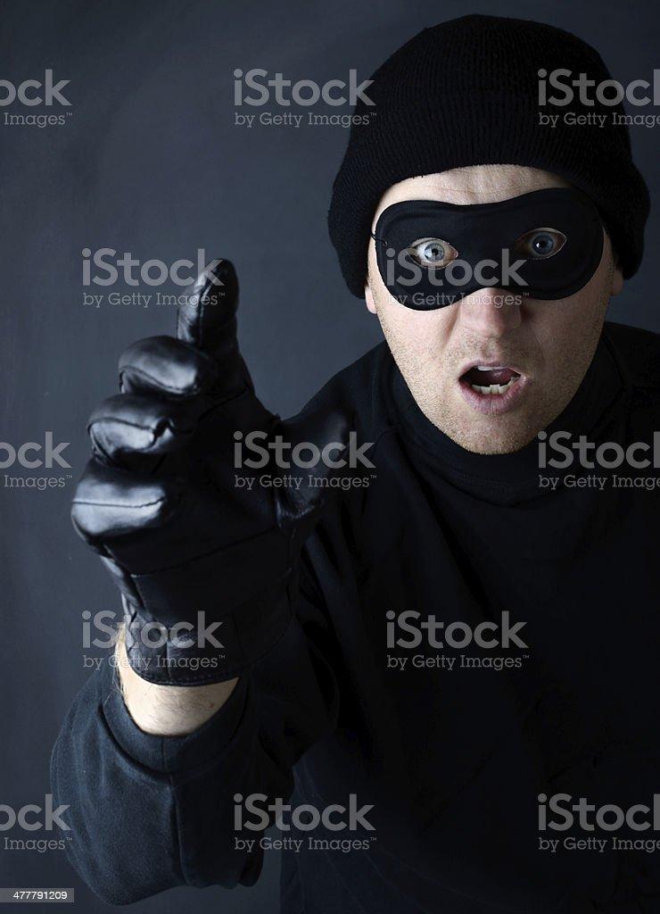 Thief grab stock photo