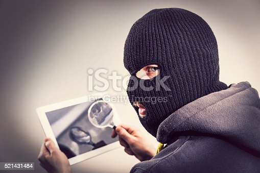 istock Thief hacking tablet mobile security 521431484