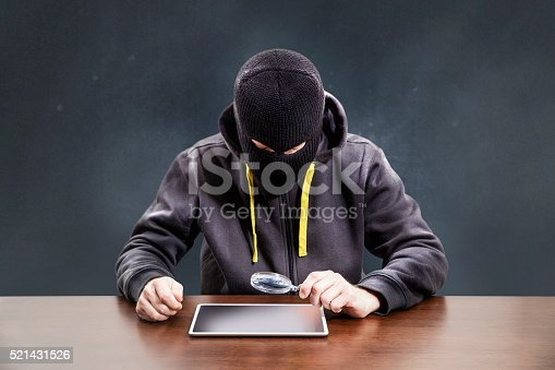 istock Thief hacking tablet mobile security 521431526