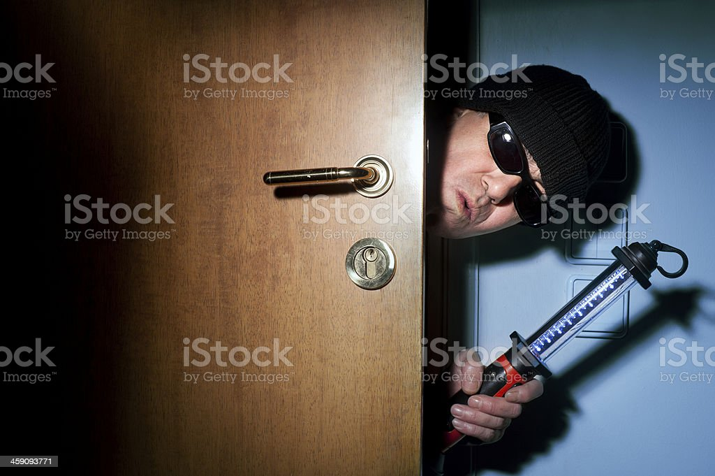 Thief in a house royalty-free stock photo