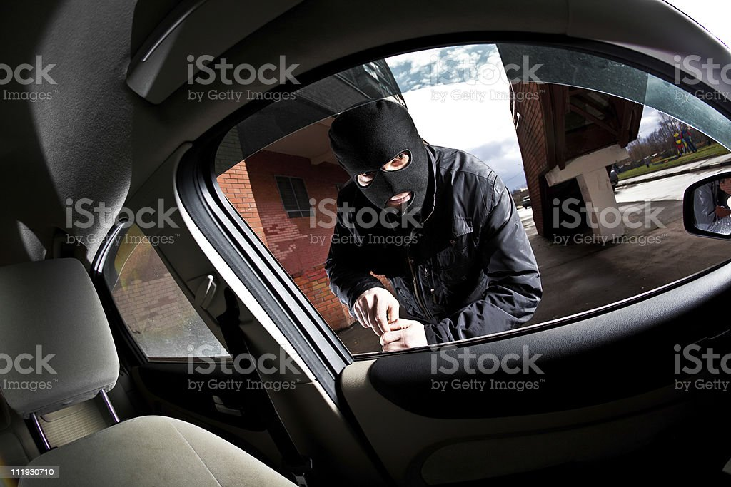 thief in a mask hijacks the car royalty-free stock photo
