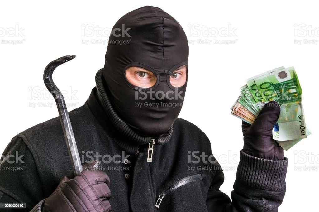 Thief in balaclava with stolen money isolated on white stock photo