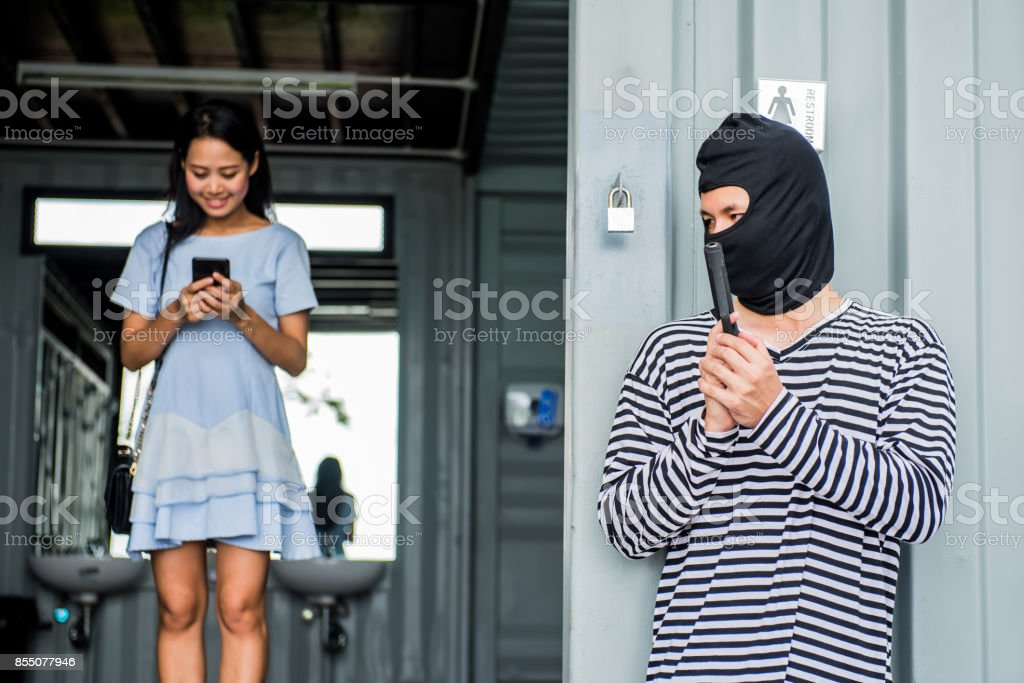 Thief is trying to steal at the public place stock photo