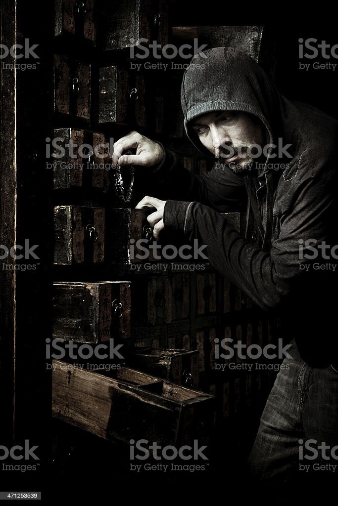 thief stealing a watch stock photo