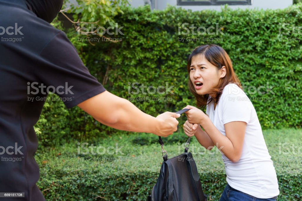 Thief Stealing And Jerking Handbag From Young Woman At