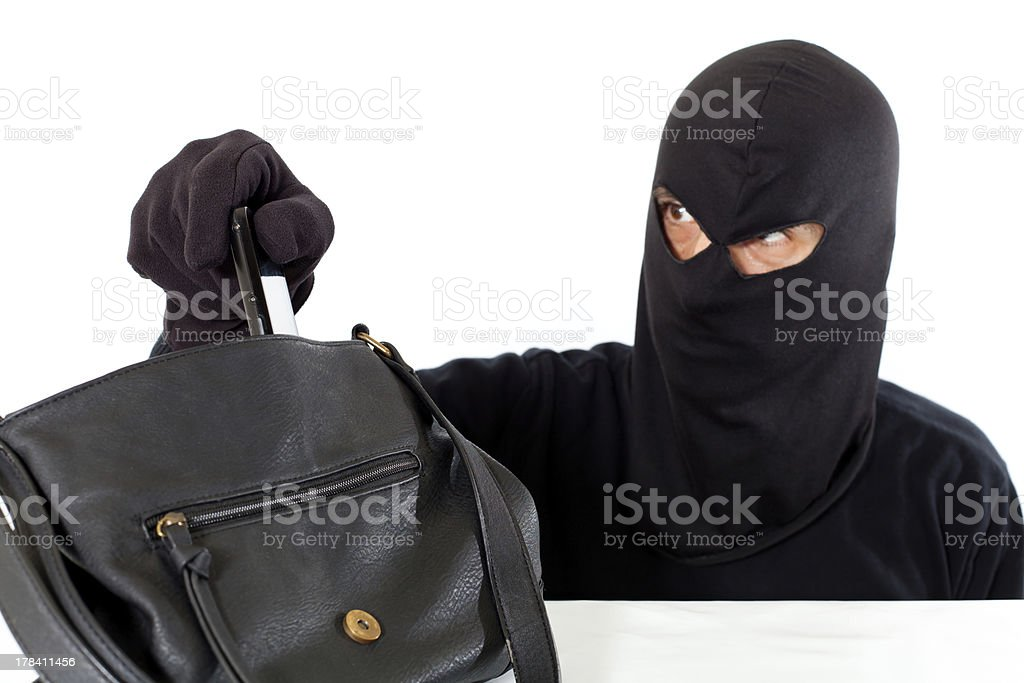 Thief stealing royalty-free stock photo