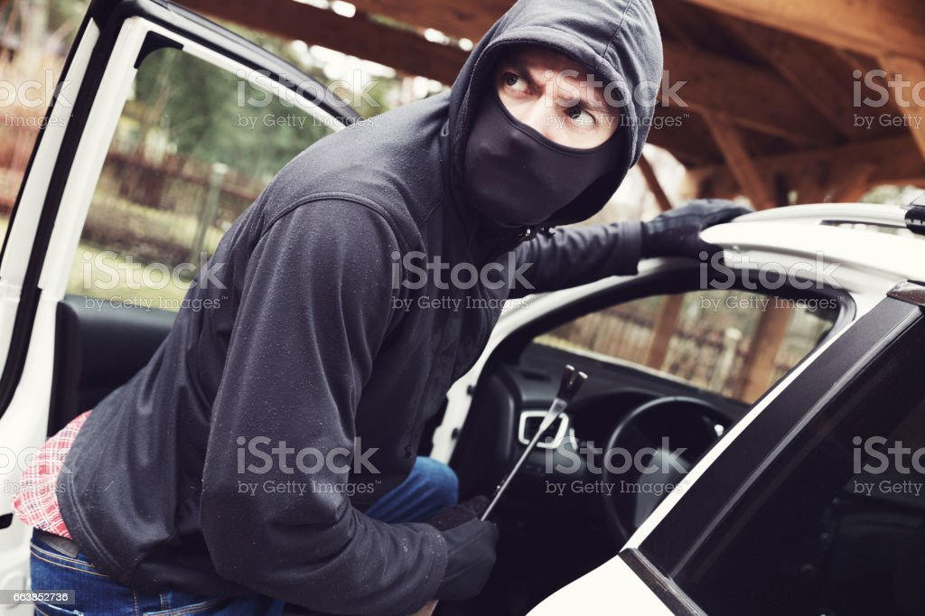 thief steals car stock photo