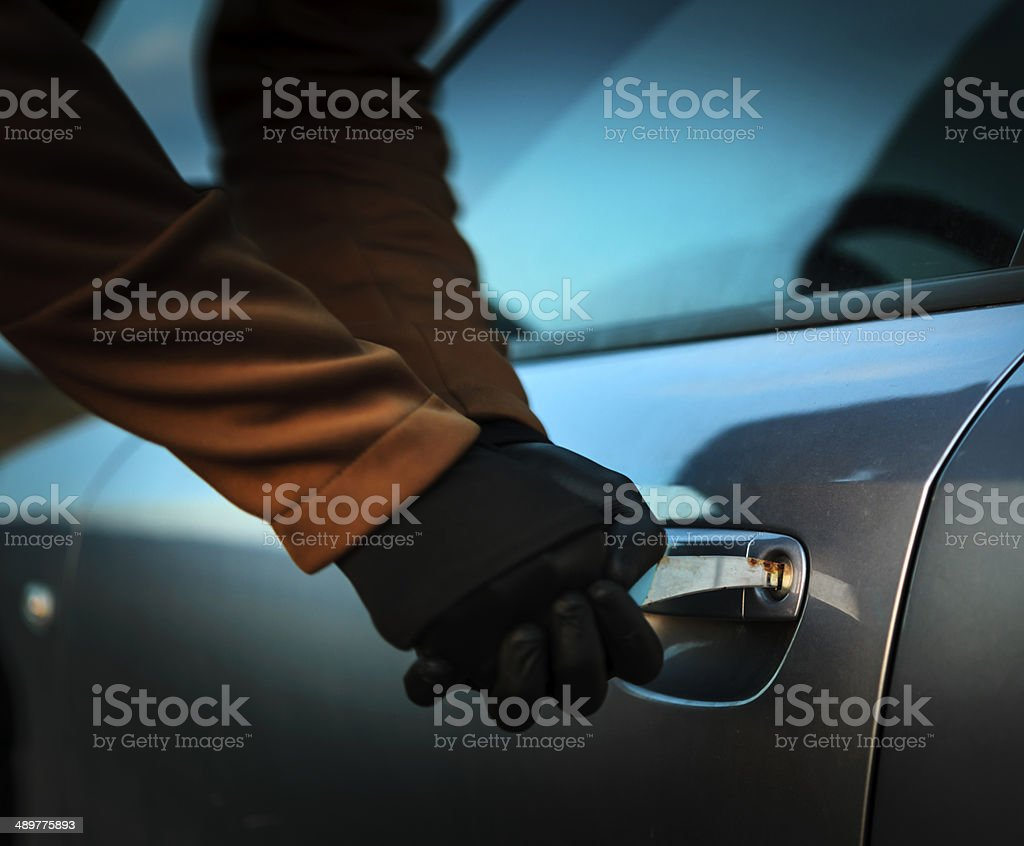 thief steling car stock photo
