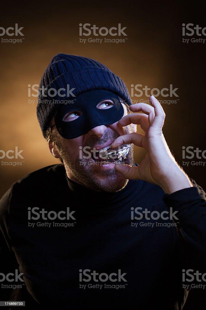 Thief Testing the Purity of a Big Diamond stock photo