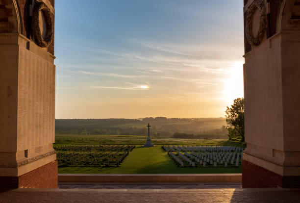 Thiepval Memorial, France Thiepval, Departement Somme, May 18, 2018. A view of the Thiepval Memorial to the Missing of the Somme at sunset with the Franco-German cemetery containing the graves of 300 unknown French and 300 unknown British soldiers who died in the First World War. somme stock pictures, royalty-free photos & images