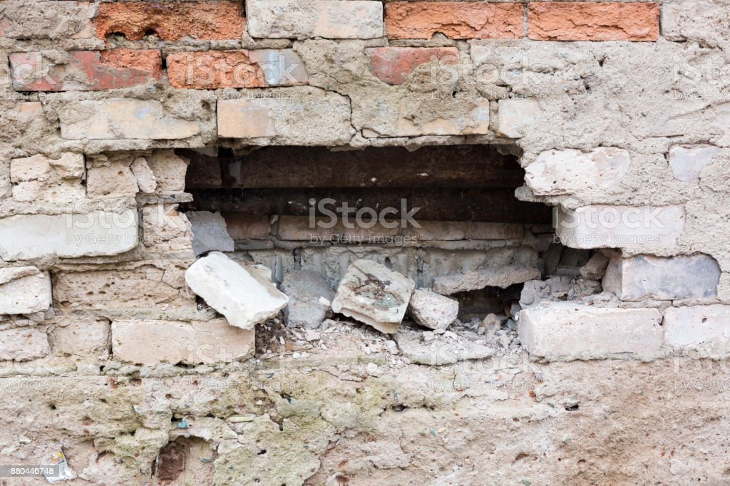 Thieves robbers smashed a brick wall. stock photo