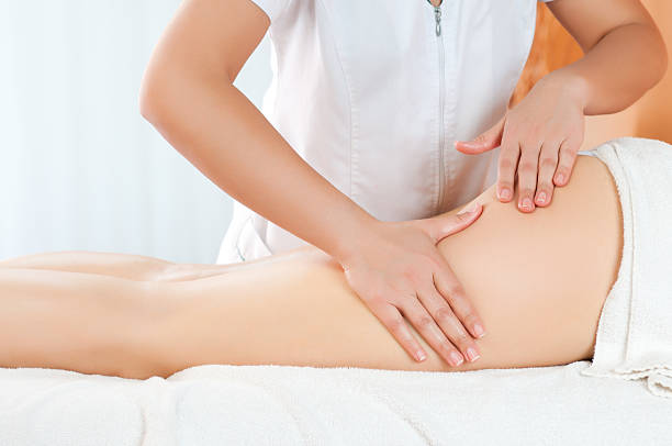thighs massage - human leg stock photos and pictures