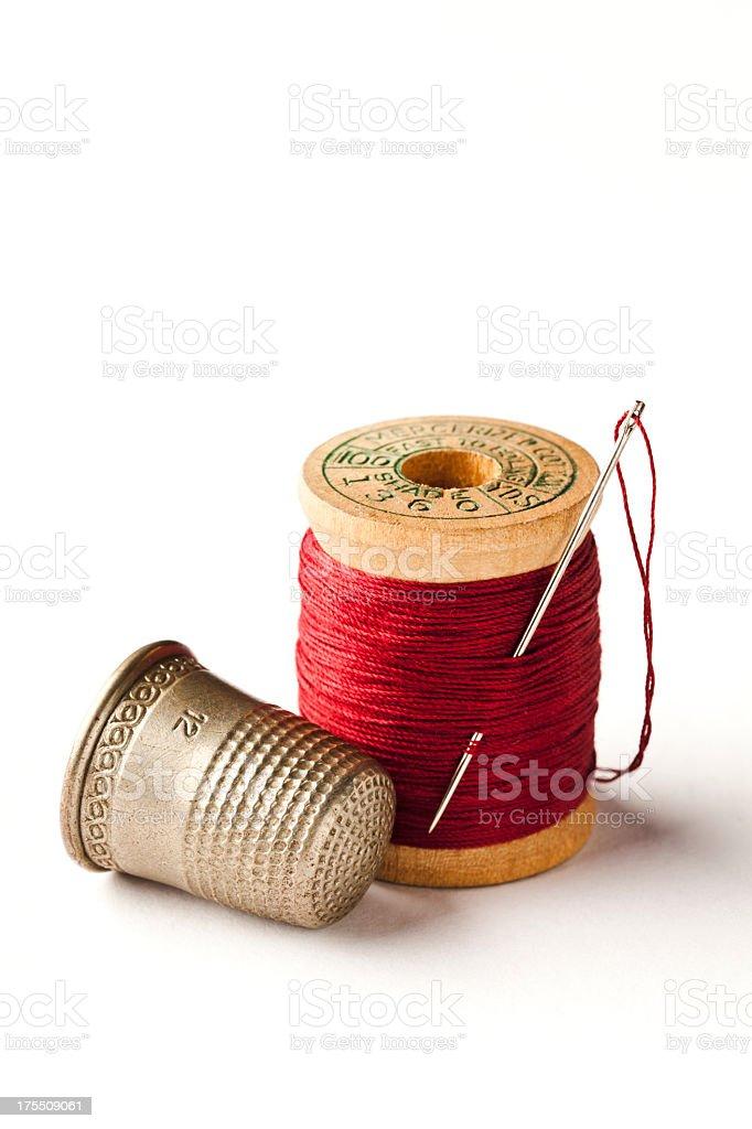 Thimble, Needle and Spool of Thread on White. stock photo