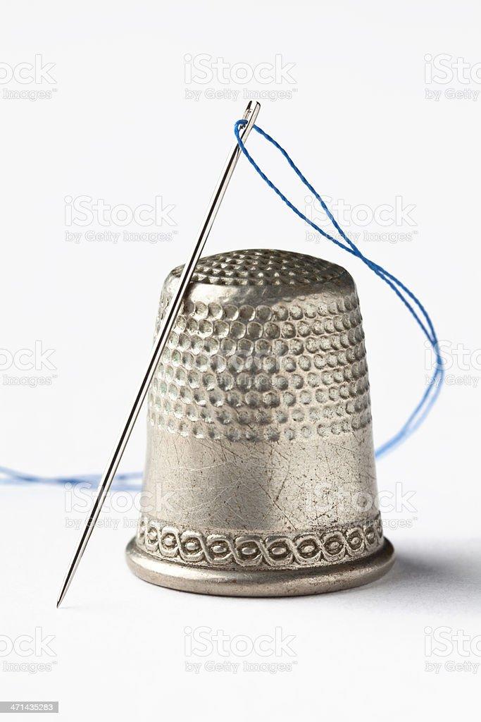 Thimble, Needle and Thread on White stock photo