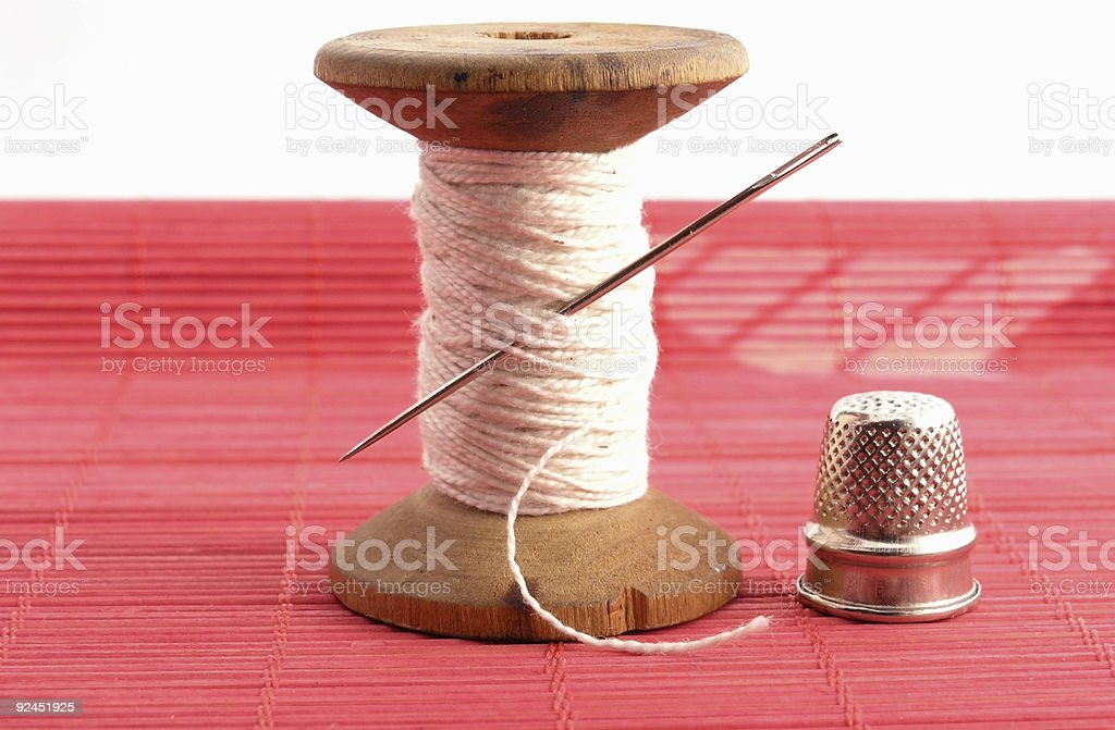 thimble, needle and thread royalty-free stock photo