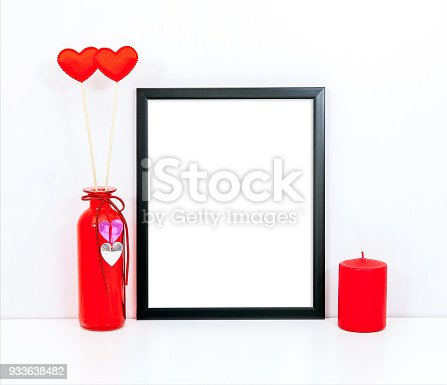 istock thin black frame mockup with a red candle and hearts 933638482