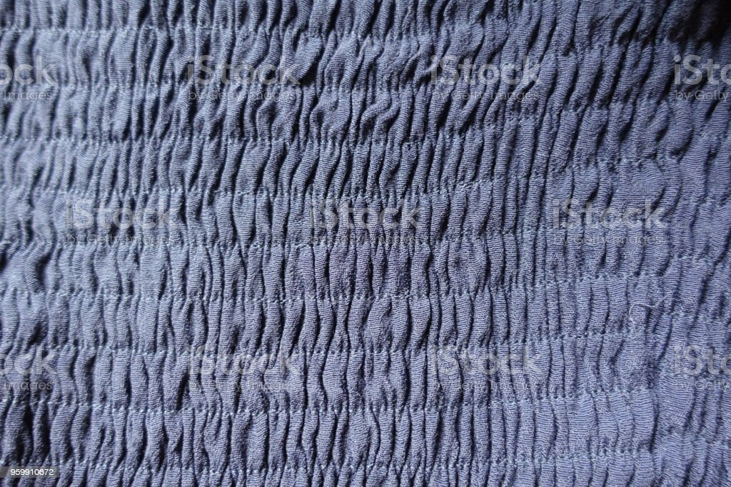 Thin blue fabric with shirring from above stock photo