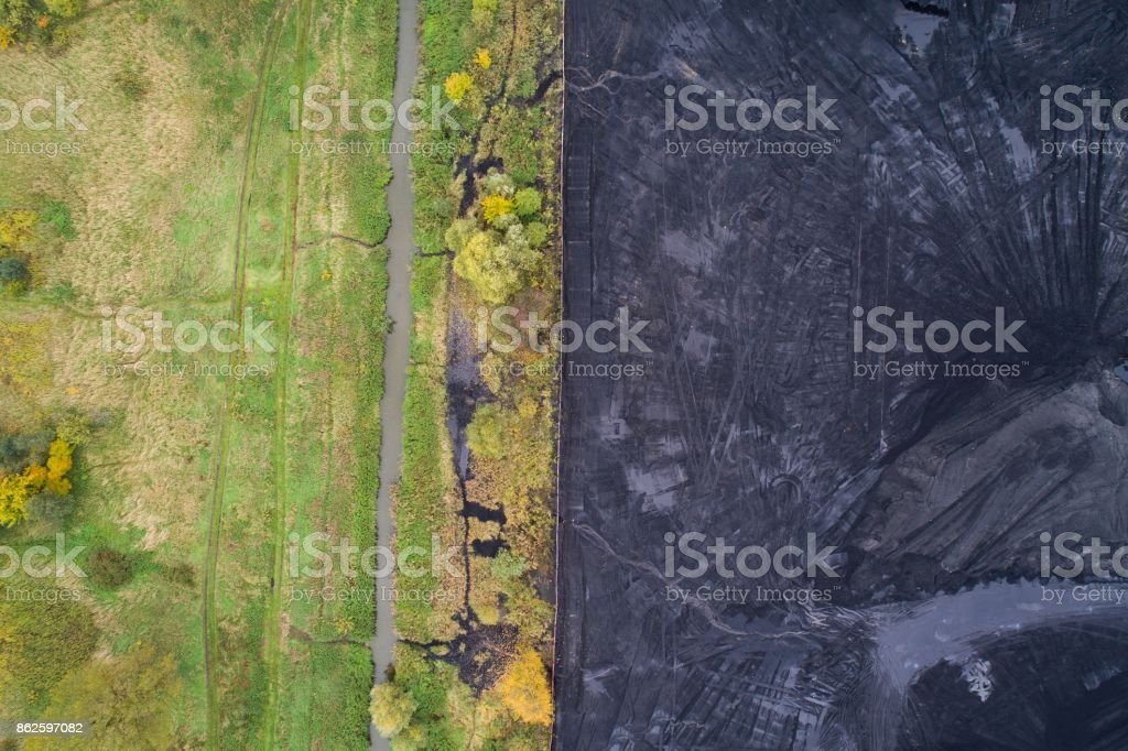 Thin border between nature and industry. stock photo