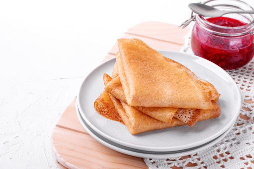 Thin crepes and raspberry jam